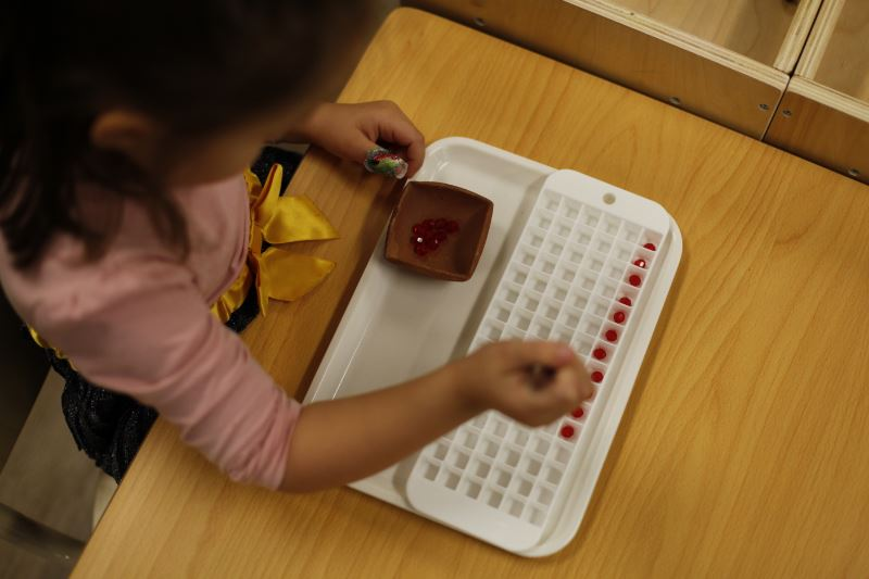 Student doing a Montessori Sensory Activity