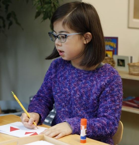 Elementary Student Working on Montessori Activity