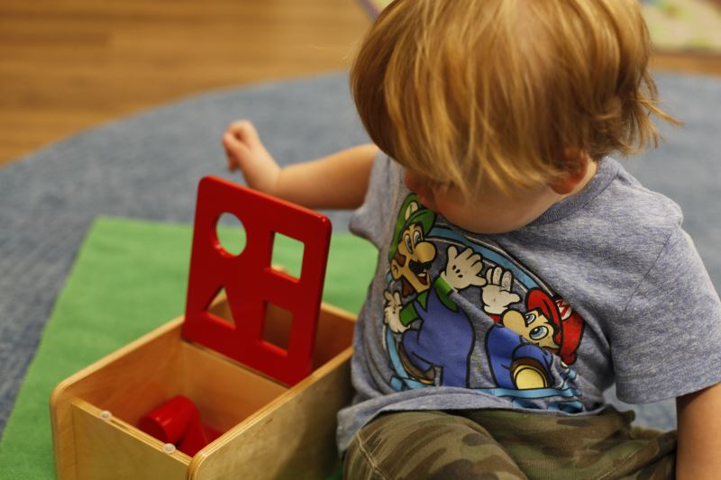 Toddler with Montessori Toy